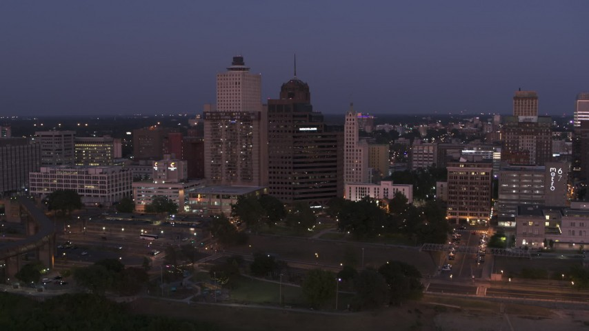 5.7K stock footage aerial video of ascend away from office high-rises at twilight in Downtown Memphis, Tennessee Aerial Stock Footage | DX0002_182_005