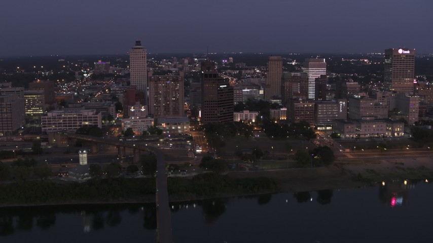 5.7K stock footage aerial video of a reverse view of downtown from across the river at twilight in Downtown Memphis, Tennessee Aerial Stock Footage | DX0002_182_006