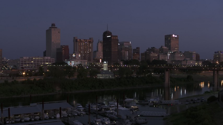 5.7K stock footage aerial video of a view of downtown from across the river at twilight during descent, Downtown Memphis, Tennessee Aerial Stock Footage | DX0002_182_008
