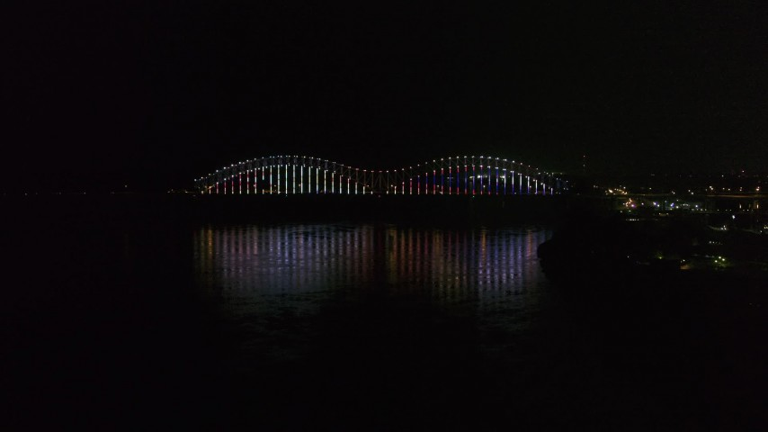 5.7K stock footage aerial video video flyby lights on the Hernando de Soto Bridge at night, Downtown Memphis, Tennessee Aerial Stock Footage | DX0002_182_010