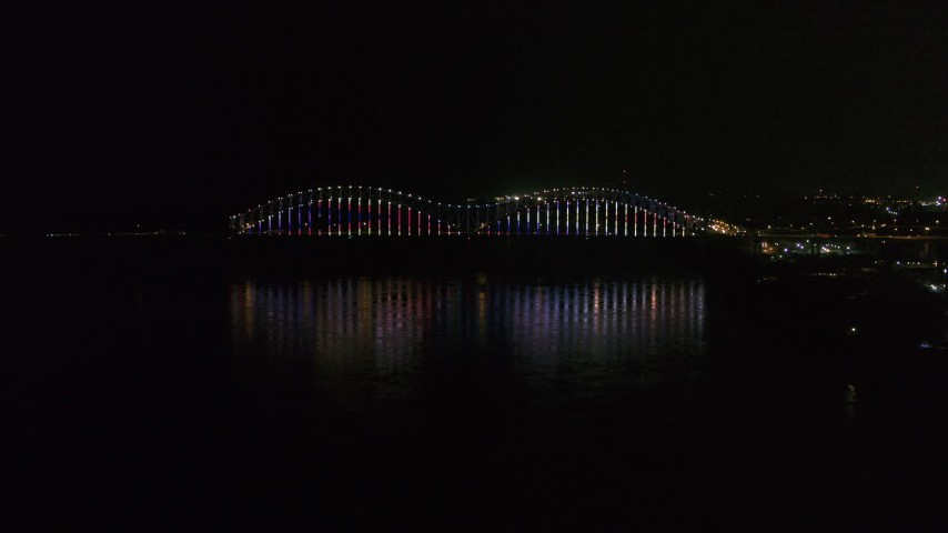 5.7K stock footage aerial video video of lights on the Hernando de Soto Bridge at night, Downtown Memphis, Tennessee Aerial Stock Footage | DX0002_182_011