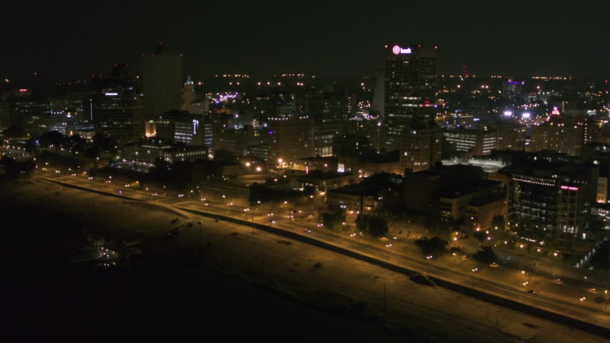 5.7K stock footage aerial video approach downtown office buildings and tilt to city street at night, Downtown Memphis, Tennessee Aerial Stock Footage | DX0002_182_013