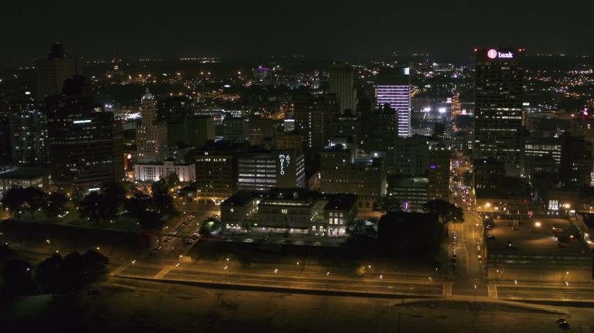 5.7K stock footage aerial video flying by downtown office buildings at night, Downtown Memphis, Tennessee Aerial Stock Footage | DX0002_182_015