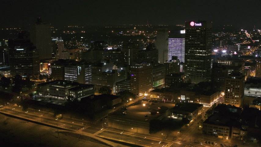 5.7K stock footage aerial video passing by downtown office buildings at night, Downtown Memphis, Tennessee Aerial Stock Footage | DX0002_182_016