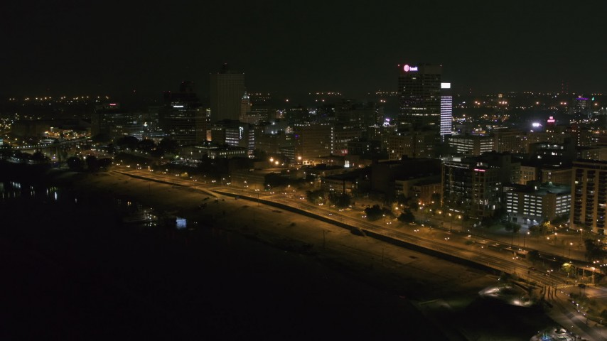 5.7K stock footage aerial video a reverse view of downtown office buildings at night, Downtown Memphis, Tennessee Aerial Stock Footage | DX0002_182_017