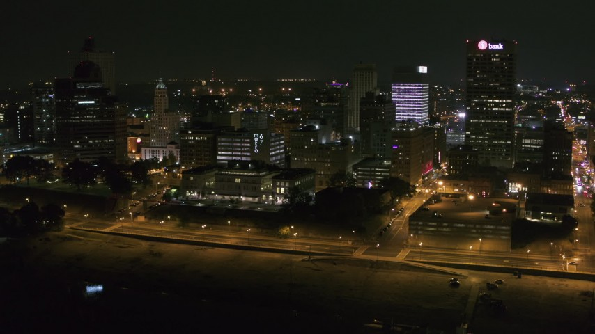 5.7K stock footage aerial video of flying by office buildings and towers at night in Downtown Memphis, Tennessee Aerial Stock Footage | DX0002_182_020