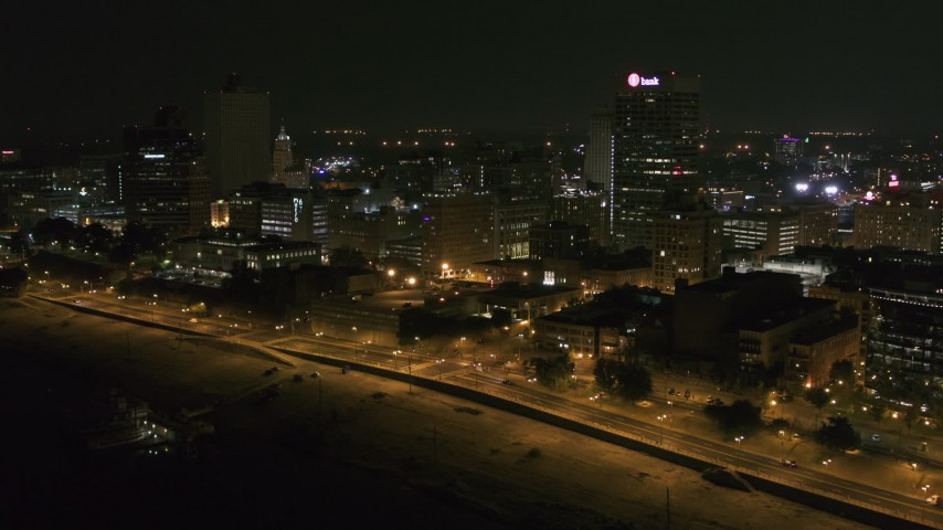 5.7K stock footage aerial video of flying by and away from office buildings and towers at night in Downtown Memphis, Tennessee Aerial Stock Footage | DX0002_182_021