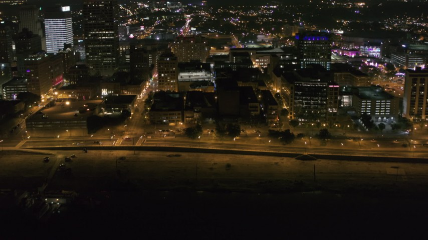 5.7K stock footage aerial video orbit office buildings and Riverside Drive at night in Downtown Memphis, Tennessee Aerial Stock Footage | DX0002_182_027