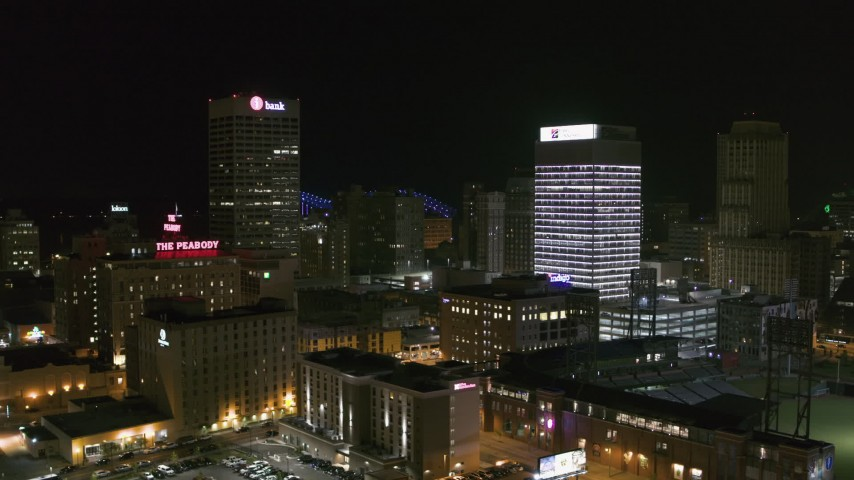 5.7K stock footage aerial video of the One Commerce Square and First Tennessee Building office towers at night in Downtown Memphis, Tennessee Aerial Stock Footage | DX0002_182_030