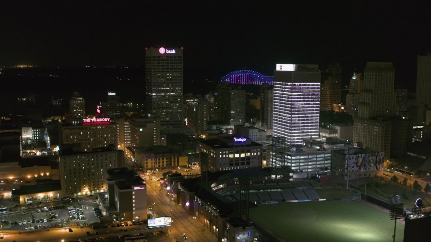5.7K stock footage aerial video reverse view of One Commerce Square and First Tennessee Building at night in Downtown Memphis, Tennessee Aerial Stock Footage | DX0002_182_032