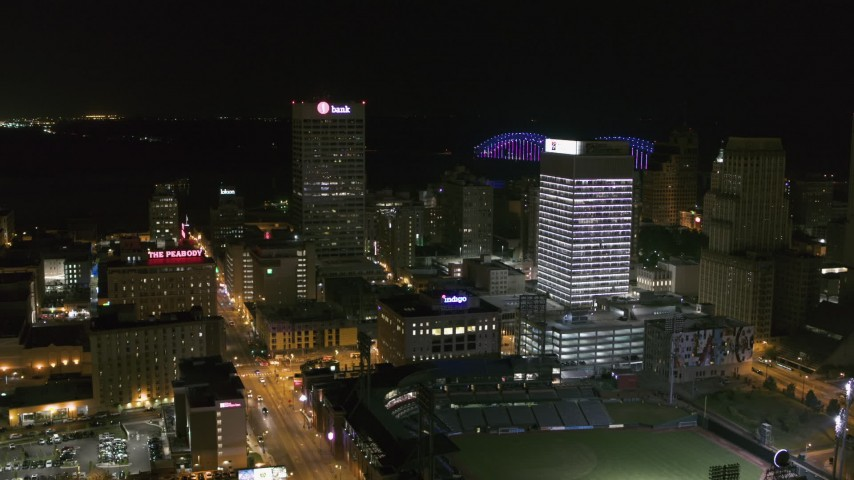 5.7K stock footage aerial video approach One Commerce Square and First Tennessee Building at night in Downtown Memphis, Tennessee Aerial Stock Footage | DX0002_182_033