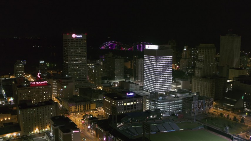5.7K stock footage aerial video orbit and fly away from One Commerce Square and First Tennessee Building at night in Downtown Memphis, Tennessee Aerial Stock Footage | DX0002_182_036