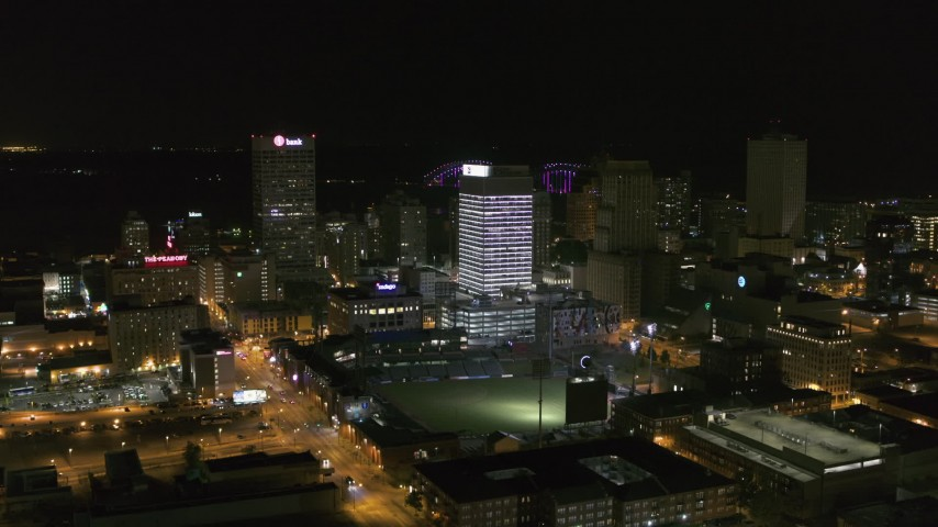 5.7K stock footage aerial video fly away from and approach One Commerce Square and First Tennessee Building at night in Downtown Memphis, Tennessee Aerial Stock Footage | DX0002_182_037