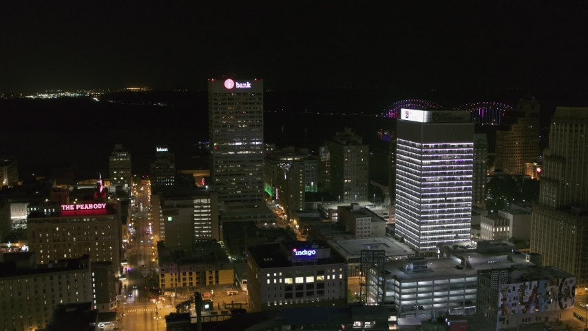 5.7K stock footage aerial video approach One Commerce Square by First Tennessee Building at night in Downtown Memphis, Tennessee Aerial Stock Footage | DX0002_182_038