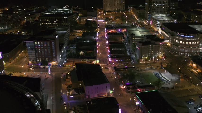 5.7K stock footage aerial video orbit intersection of Beale Street and BB King Boulevard at night in Downtown Memphis, Tennessee Aerial Stock Footage | DX0002_182_039