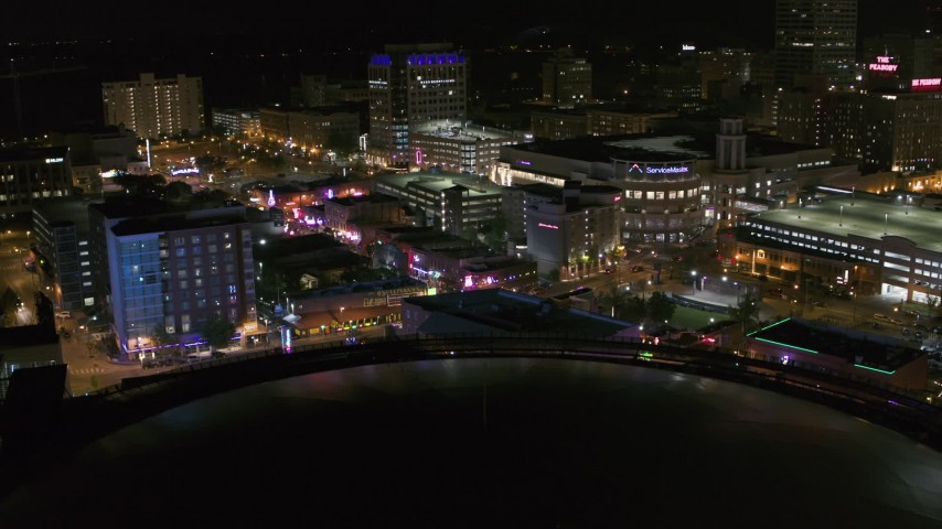 5.7K stock footage aerial video of restaurants and clubs on Beale Street at night in Downtown Memphis, Tennessee Aerial Stock Footage | DX0002_182_040