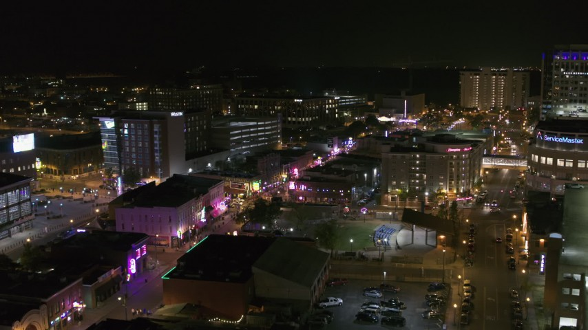 5.7K stock footage aerial video approach Beale Street and BB King Boulevard intersection at night in Downtown Memphis, Tennessee Aerial Stock Footage | DX0002_182_042
