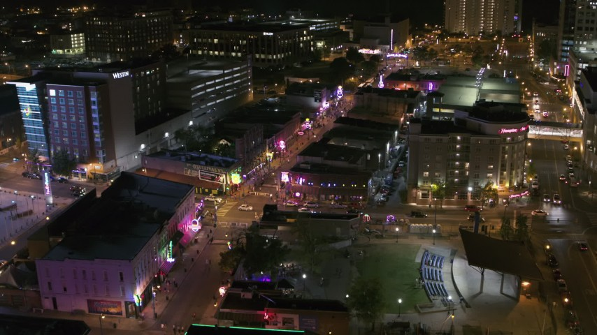 5.7K stock footage aerial video a view of Beale Street and BB King Boulevard intersection at night in Downtown Memphis, Tennessee Aerial Stock Footage | DX0002_182_043