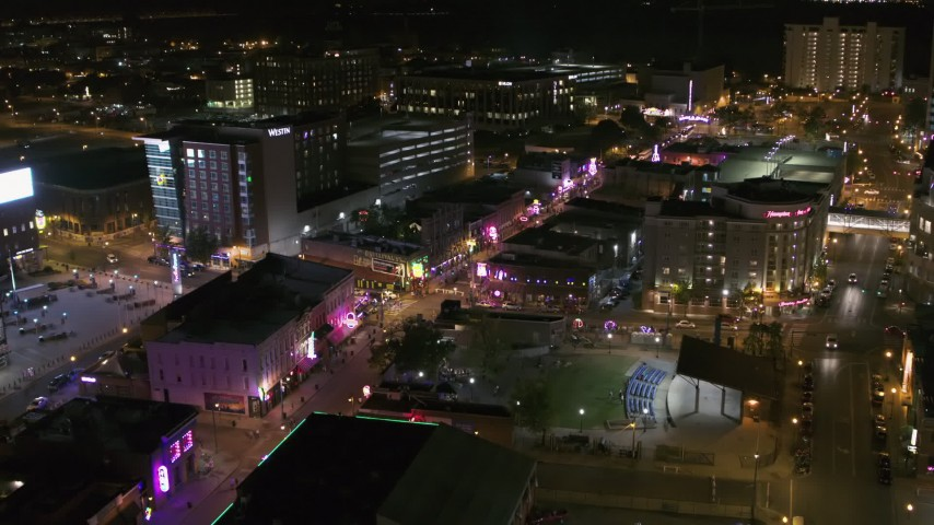 5.7K stock footage aerial video reverse view of Beale Street and BB King Boulevard intersection at night in Downtown Memphis, Tennessee Aerial Stock Footage | DX0002_182_044