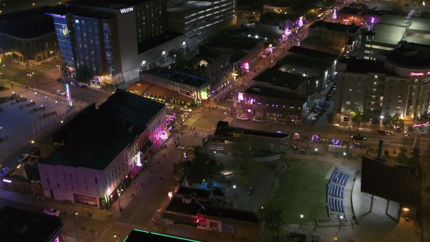 5.7K stock footage aerial video fly toward Beale Street and BB King Boulevard intersection at night in Downtown Memphis, Tennessee Aerial Stock Footage | DX0002_182_045