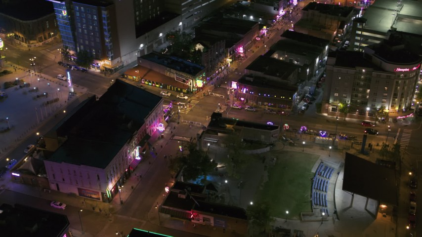 5.7K stock footage aerial video ascend away from intersection of Beale Street and BB King Boulevard at night in Downtown Memphis, Tennessee Aerial Stock Footage | DX0002_182_046