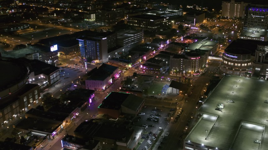 5.7K stock footage aerial video of flying away from intersection of Beale Street and BB King Boulevard at night in Downtown Memphis, Tennessee Aerial Stock Footage | DX0002_182_047