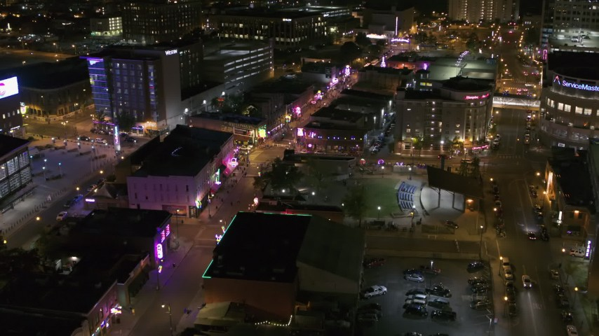 5.7K stock footage aerial video fly away from and past Beale Street and BB King Boulevard at night in Downtown Memphis, Tennessee Aerial Stock Footage | DX0002_182_049