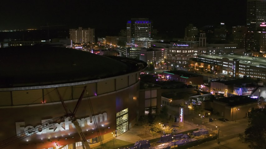 5.7K stock footage aerial video stationary view of FedEx Forum and Beale Street clubs at night in Downtown Memphis, Tennessee Aerial Stock Footage | DX0002_182_050