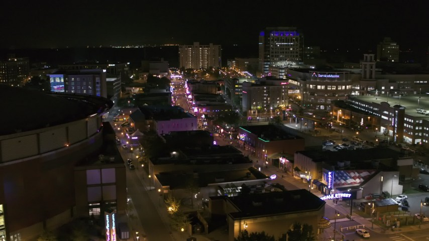 5.7K stock footage aerial video flyby FedEx Forum to reveal Beale Street clubs at night in Downtown Memphis, Tennessee Aerial Stock Footage | DX0002_182_051