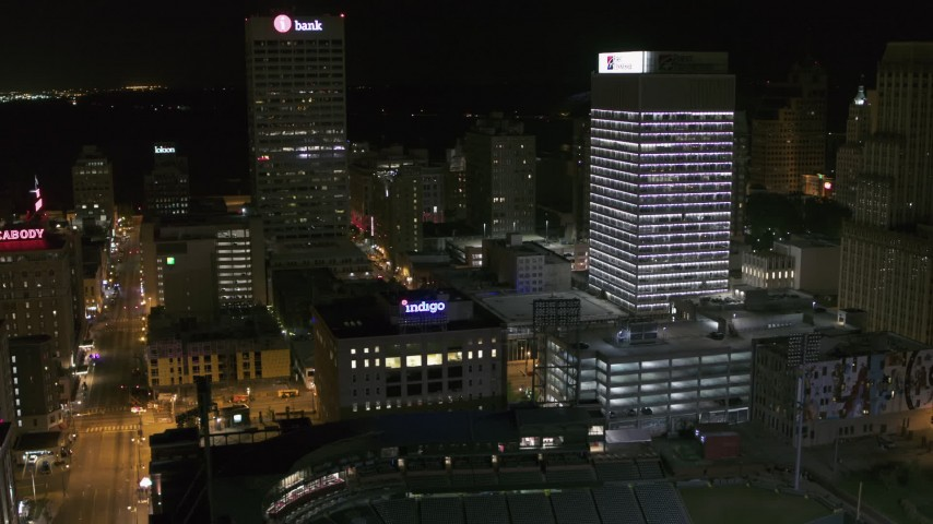 5.7K stock footage aerial video flyby One Commerce Square and First Tennessee Building at night, reveal Monroe Avenue, Downtown Memphis, Tennessee Aerial Stock Footage | DX0002_182_052