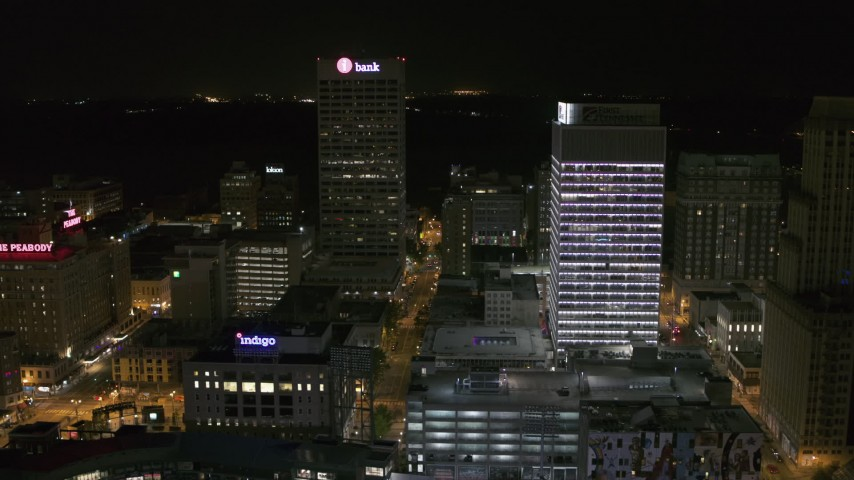 5.7K stock footage aerial video of One Commerce Square and First Tennessee Building at night by Monroe Avenue, Downtown Memphis, Tennessee Aerial Stock Footage | DX0002_182_053