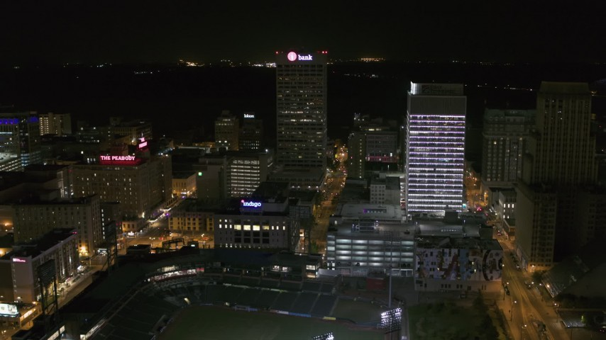 5.7K stock footage aerial video fly away from and orbit One Commerce Square and First Tennessee Building at night by Monroe Avenue, Downtown Memphis, Tennessee Aerial Stock Footage | DX0002_182_054