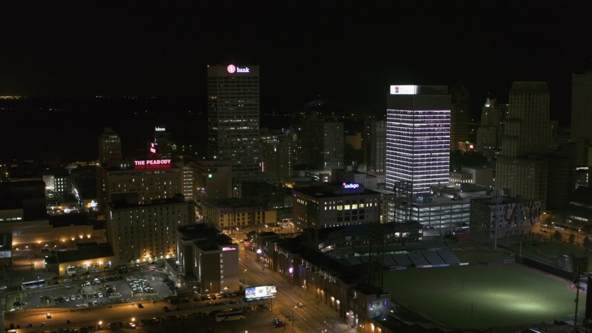 5.7K stock footage aerial video view of One Commerce Square and First Tennessee Building at night, slow descent, Downtown Memphis, Tennessee Aerial Stock Footage | DX0002_182_055