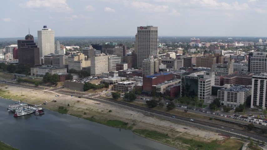 5.7K stock footage aerial video of reverse view of One Commerce Square and office buildings, Downtown Memphis, Tennessee Aerial Stock Footage | DX0002_183_003