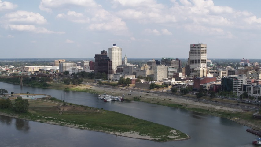 5.7K stock footage aerial video of flying by and away from the city's skyline, Downtown Memphis, Tennessee Aerial Stock Footage DX0002_183_004 | Axiom Images