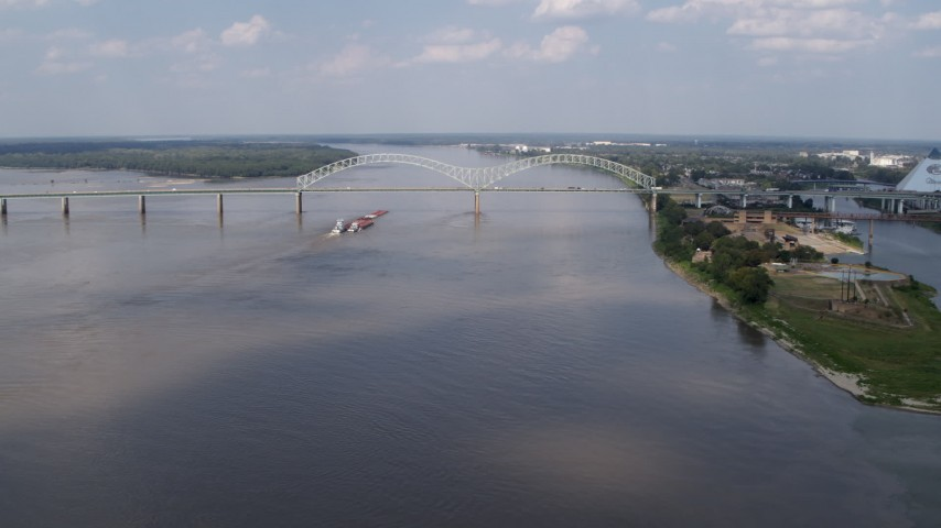 5.7K stock footage aerial video a stationary view of the Hernando de Soto Bridge and Mississippi River, Memphis, Tennessee Aerial Stock Footage | DX0002_183_009