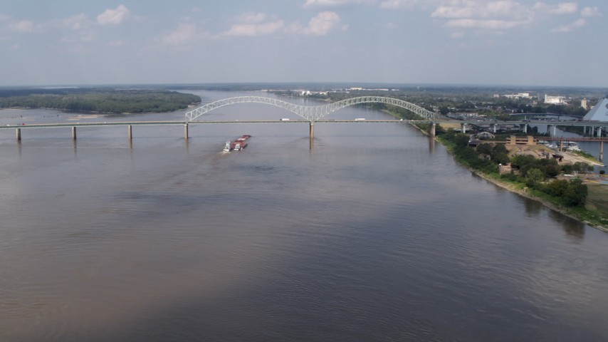 5.7K stock footage aerial video a wide orbit of the Hernando de Soto Bridge and Mississippi River, Memphis, Tennessee Aerial Stock Footage | DX0002_183_010