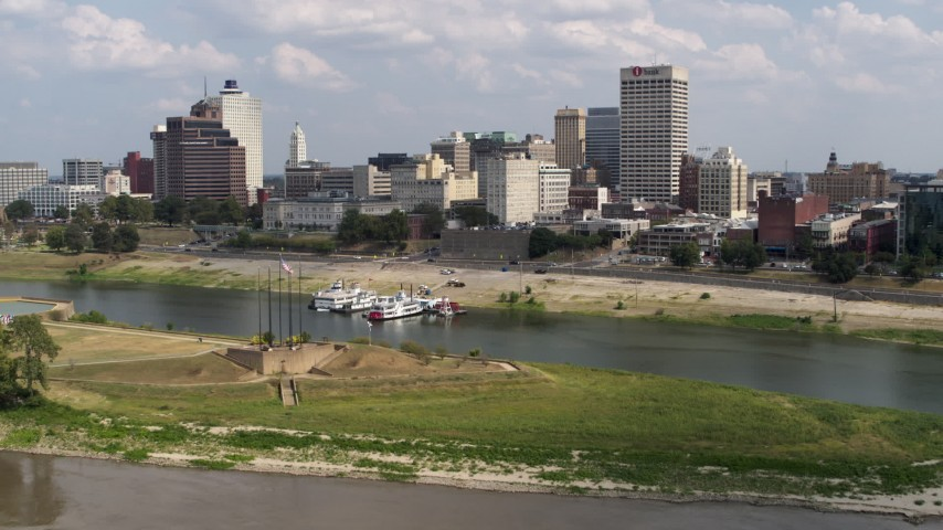 5.7K stock footage aerial video flying low over the river toward the city's skyline in Downtown Memphis, Tennessee Aerial Stock Footage | DX0002_183_012