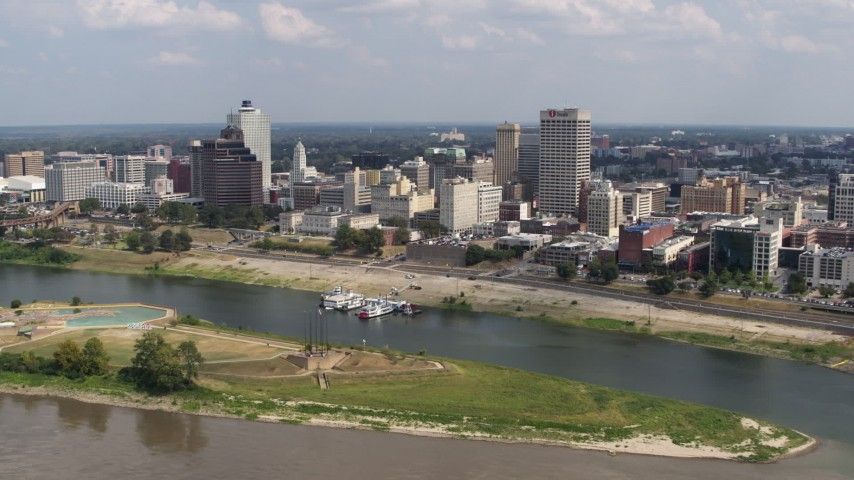 5.7K stock footage aerial video flying away the city's skyline to the Mississippi River, Downtown Memphis, Tennessee Aerial Stock Footage | DX0002_183_013