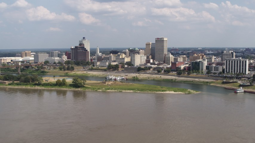 5.7K stock footage aerial video of city's skyline across the Mississippi River, Downtown Memphis, Tennessee Aerial Stock Footage | DX0002_183_014