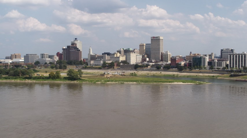 5.7K stock footage aerial video approach city's skyline across the Mississippi River, Downtown Memphis, Tennessee Aerial Stock Footage | DX0002_183_015