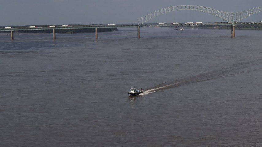 5.7K stock footage aerial video of tracking a boat racing across the Mississippi River, Memphis, Tennessee Aerial Stock Footage | DX0002_183_019