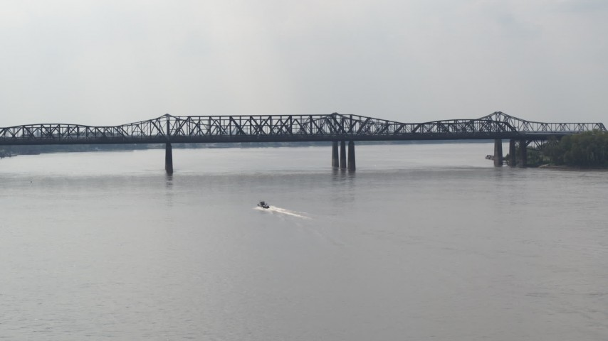 5.7K stock footage aerial video of a boat speeding across the Mississippi River toward Harahan Bridge, Memphis, Tennessee Aerial Stock Footage | DX0002_183_021