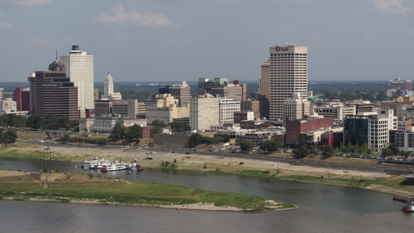 5.7K stock footage aerial video of One Commerce Square towering over city buildings, Downtown Memphis, Tennessee Aerial Stock Footage | DX0002_183_023