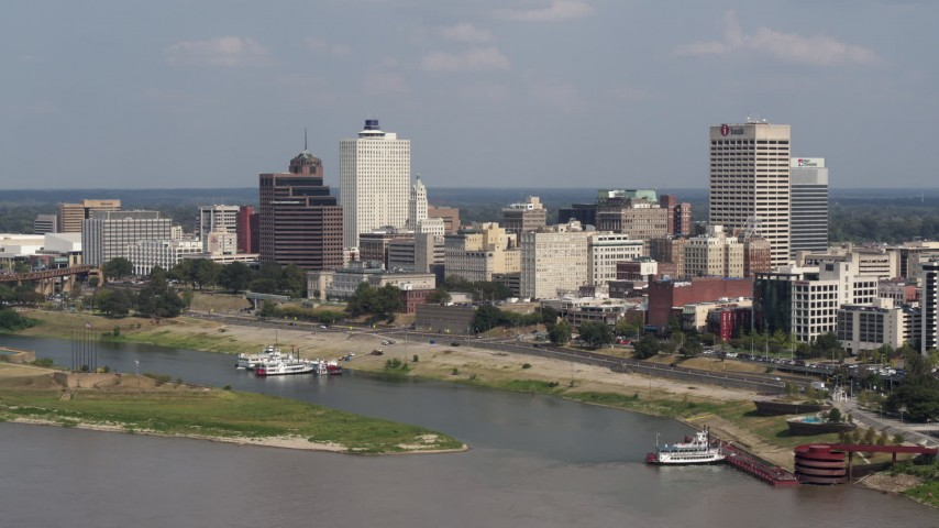 5.7K stock footage aerial video of orbiting city buildings between office towers, Downtown Memphis, Tennessee Aerial Stock Footage | DX0002_183_025
