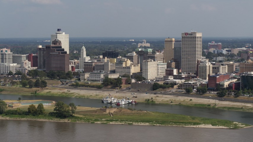 5.7K stock footage aerial video of downtown buildings between office towers, Downtown Memphis, Tennessee Aerial Stock Footage | DX0002_183_026