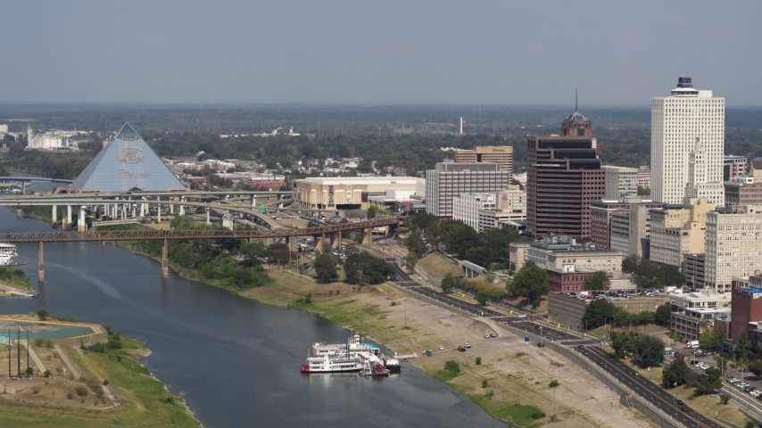 5.7K stock footage aerial video of Wolf River Harbor and a bridge between pyramid and office towers, Downtown Memphis, Tennessee Aerial Stock Footage | DX0002_183_030