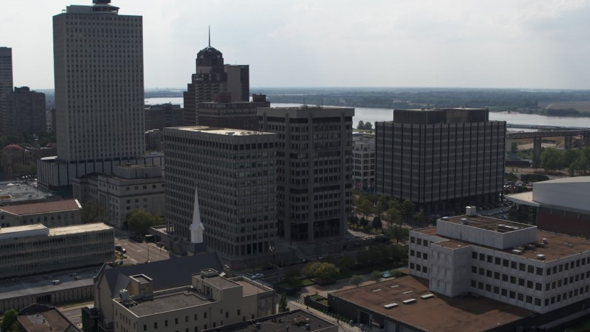 5.7K stock footage aerial video of slowly circling a county government building beside police station in Downtown Memphis, Tennessee Aerial Stock Footage | DX0002_184_011