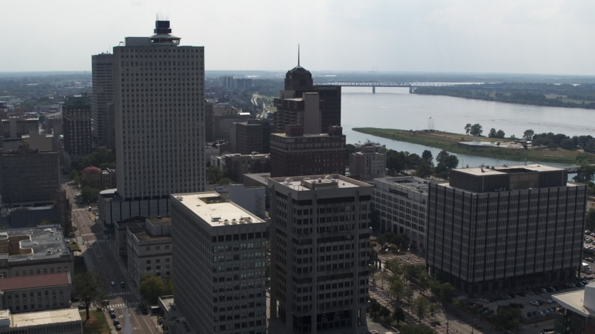 5.7K stock footage aerial video of office high-rise behind a county building and police station in Downtown Memphis, Tennessee Aerial Stock Footage | DX0002_184_012
