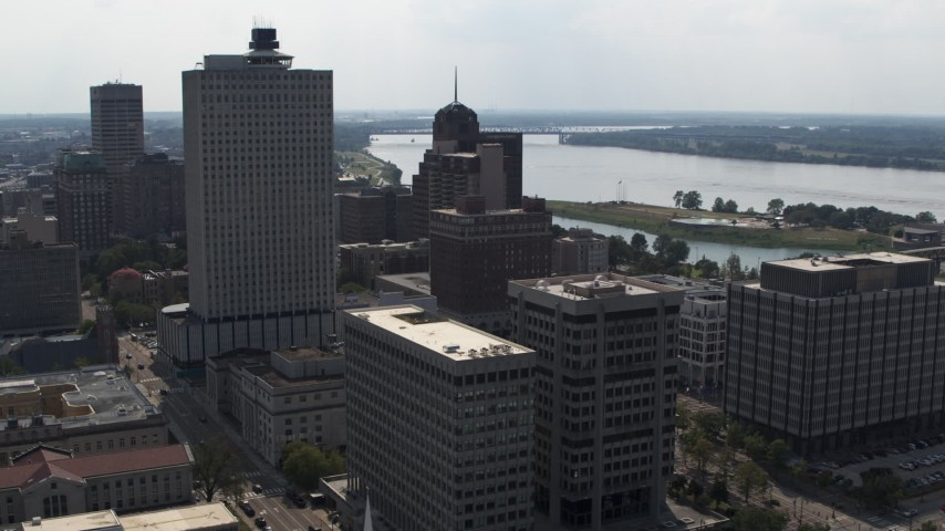 5.7K stock footage aerial video reverse view of office high-rise, a county building and police station in Downtown Memphis, Tennessee Aerial Stock Footage | DX0002_184_013